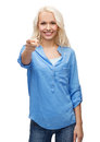 Smiling woman pointing finger at you happiness gesture and people concept Stock Images