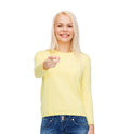 Smiling woman pointing finger at you happiness gesture and people concept Royalty Free Stock Images