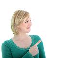 Smiling woman pointing with her finger Stock Image