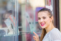 Smiling woman pointing on showcase Stock Photography