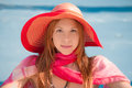 Smiling woman in pool an portrait of a young a hat and scarf a Royalty Free Stock Image
