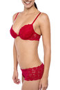 Smiling woman posing with bikini body of young beautiful in red lingerie Stock Images