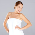 Smiling woman posing in a white towel Royalty Free Stock Photo