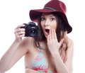Smiling woman with professional camera a isiolated Stock Photography