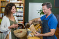 Smiling woman purchasing bread at bakery store Royalty Free Stock Photo