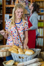Smiling woman purchasing bread Royalty Free Stock Photo