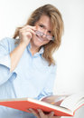 Smiling woman reading a book bespectacled Stock Photography