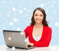 Smiling woman in red clothes with laptop computer christmas x mas electronics gadget concept Royalty Free Stock Photos
