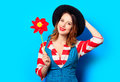 Smiling woman with red pinwheel Royalty Free Stock Photo