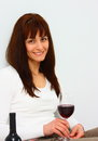 Smiling woman relaxing glass red wine isolated Stock Photos