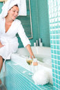 Smiling woman relaxing wrapped towel bathroom bathtub Royalty Free Stock Photo
