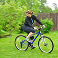 Smiling woman riding the bike Stock Photo