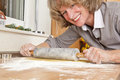 Smiling woman rolling dough Stock Photos