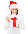 Smiling woman in santa helper hat with gift box christmas x mas winter happiness concept Stock Image