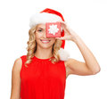 Smiling woman in santa helper hat with gift box christmas x mas winter happiness concept small jewelry Royalty Free Stock Photography