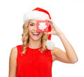 Smiling woman in santa helper hat with gift box christmas x mas winter happiness concept small jewelry Stock Image
