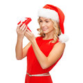 Smiling woman in santa helper hat with gift box christmas x mas winter happiness concept small jewelry Stock Photo
