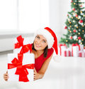 Smiling woman in santa helper hat with gift boxes christmas x mas winter happiness concept many Royalty Free Stock Images