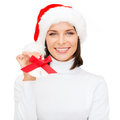 Smiling woman in santa helper hat and jingle bells christmas x mas winter happiness concept with Royalty Free Stock Photo