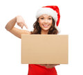 Smiling woman in santa helper hat with parcel box christmas x mas winter happiness concept Royalty Free Stock Photos
