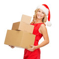 Smiling woman in santa helper hat with parcels christmas x mas winter happiness concept blonde many parcel boxes Stock Photos