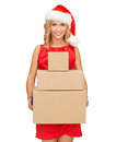 Smiling woman in santa helper hat with parcels christmas x mas winter happiness concept many parcel boxes Stock Images