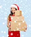 Smiling woman in santa helper hat with parcels christmas x mas winter happiness concept many parcel boxes Stock Photography