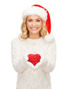 Smiling woman in santa helper hat with red heart christmas x mas winter charity love happiness concept Stock Image