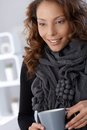 Smiling woman in scarf with tea mug Royalty Free Stock Photo