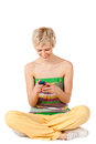 Smiling woman sending sms Stock Image