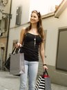 Smiling woman shopping in the city photo of a beautiful young walking through holding bags Stock Photos