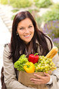 Smiling woman shopping vegetables groceries paper bag Royalty Free Stock Photo
