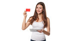 Smiling woman showing blank credit card hold tablet pc in hand, in white t-shirt, isolated over white background Royalty Free Stock Photo