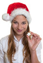 Smiling woman showing christmas cake attractive with long blond hair and in her hand looking at camera on a white background Stock Photography