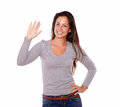 Smiling woman showing greeting gesture with hand portrait of a on white background Royalty Free Stock Photography