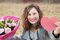 Smiling woman showing her Valentine's gifts Royalty Free Stock Images