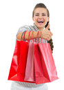 Smiling woman showing thumbs up with shopping bags Stock Photography