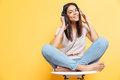 Smiling woman sitting on the chair with headset Royalty Free Stock Photo