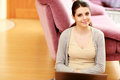 Smiling woman sitting on the floor with laptop young beautiful Royalty Free Stock Photos