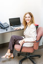 Smiling woman sitting at office desk happy businesswoman workstation in with computer Royalty Free Stock Photos
