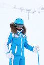 Smiling woman skier looks at camera Royalty Free Stock Images