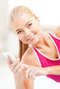 Smiling woman with smartphone Stock Photo