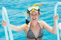 Smiling woman with snorkel equipment Stock Images