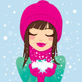 Smiling woman with snow beautiful brunette eyes closed and in pink winter hat and scarf holding her hands Royalty Free Stock Image