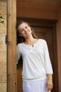 Smiling woman standing on doorstep Royalty Free Stock Photo