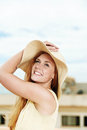 Smiling woman with straw hat cheerful young in strawhat standing the sky Royalty Free Stock Photo