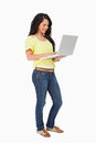 Smiling woman student standing with a laptop Royalty Free Stock Photography