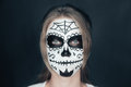 Smiling woman with sugar skull makeup
