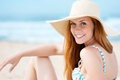Smiling woman in sun hat at beach portrait of a young sunhat the Royalty Free Stock Photography