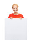 Smiling woman in sweater with blank white board people advertisement and sale concept happy Stock Image